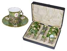 A SET OF SIX GEORGE V SILVER HOLDERS WITH DEMITASSE