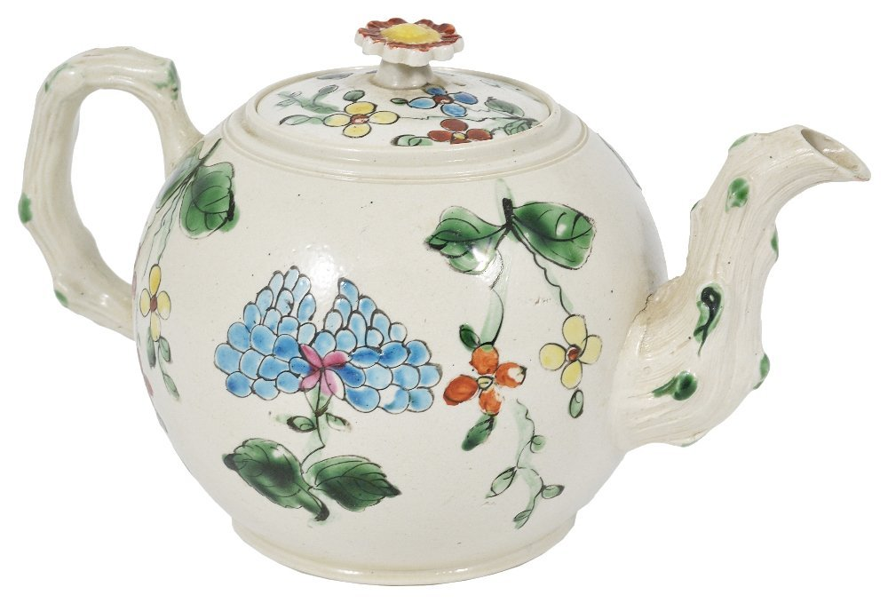 A STAFFORDSHIRE SALT-GLAZED STONEWARE TEAPOT AND COVER,
