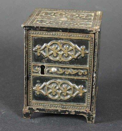 118: Savings box (iron) shaped like a safe, c. 1900/192