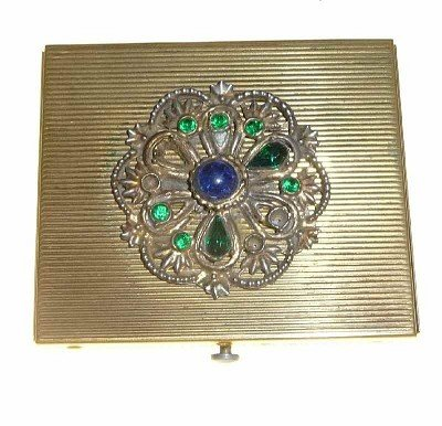 129: Brass box, filigree work, cover with colored stone