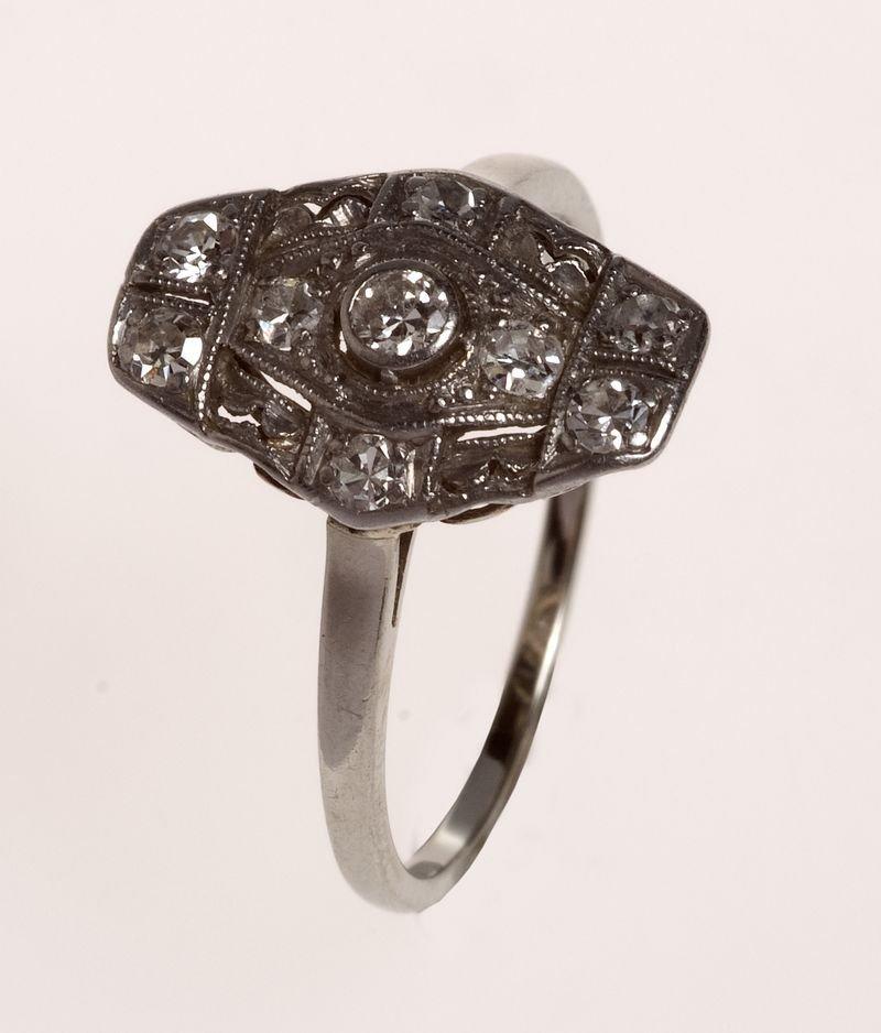 2: Women, Art Deco, WG 14K hallmarked, a diamond center