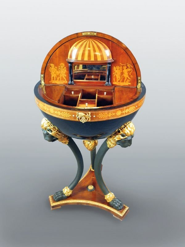678: Ebonized globe table on three legs in the form of
