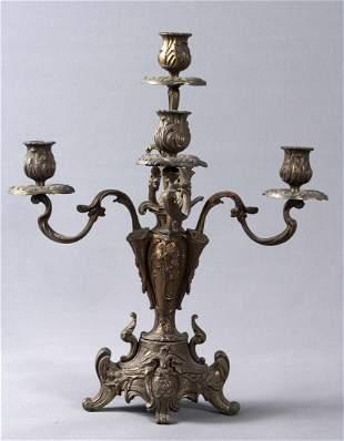 Brass candlesticks, supplemented with Rocaillenzier