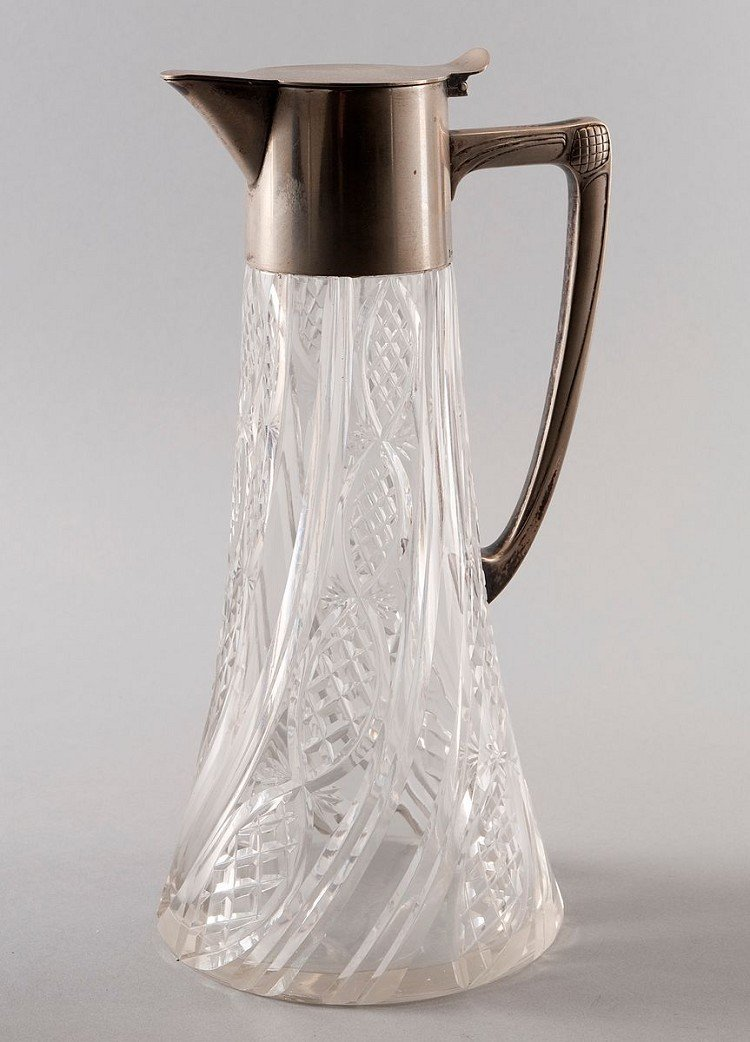 Glass carafe with simple silver outfit, flat hinged lid