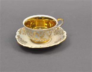 Collection cup, saucer with gilt interior, rich floral