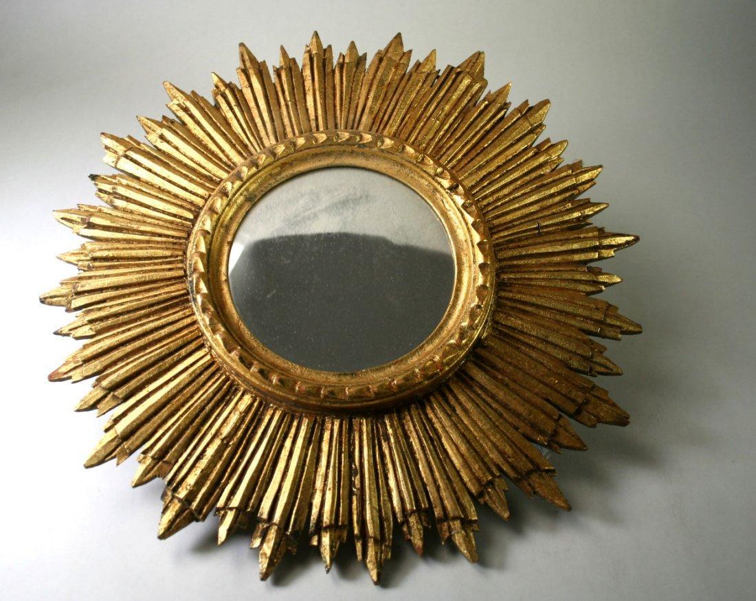 Strahlenkranz mit altem Spiegelglas, goldfarbenes Holz,