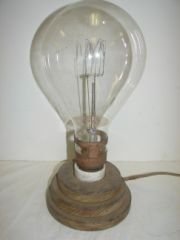 13: Large Antique Light Bulb Mounted on Wood base