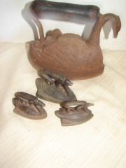 14: Group of 4 Swan Shaped Irons