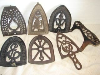15: Group of 7 Iron Trivets