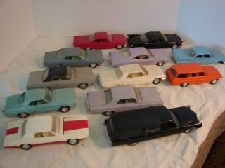 6: 12 Plastic Model Cars Assorted