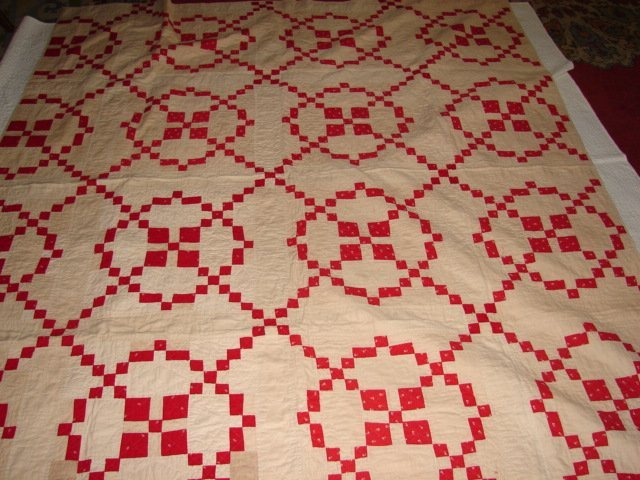 Red and White Hand Stitched Quilt
