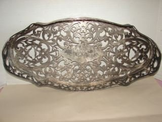 """Silver Plate Tray 21"""" long 2"""" high silver plate tray."""