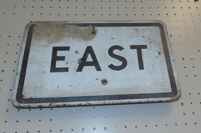 "Metal Sign ""EAST"""