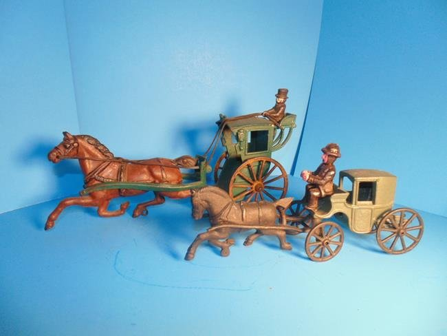 2 Horse Drawn Cast Iron Carriages