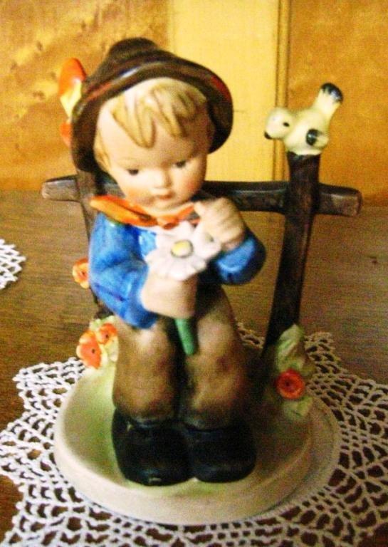 7: Hummel Figurine She Loves Me Not. 114