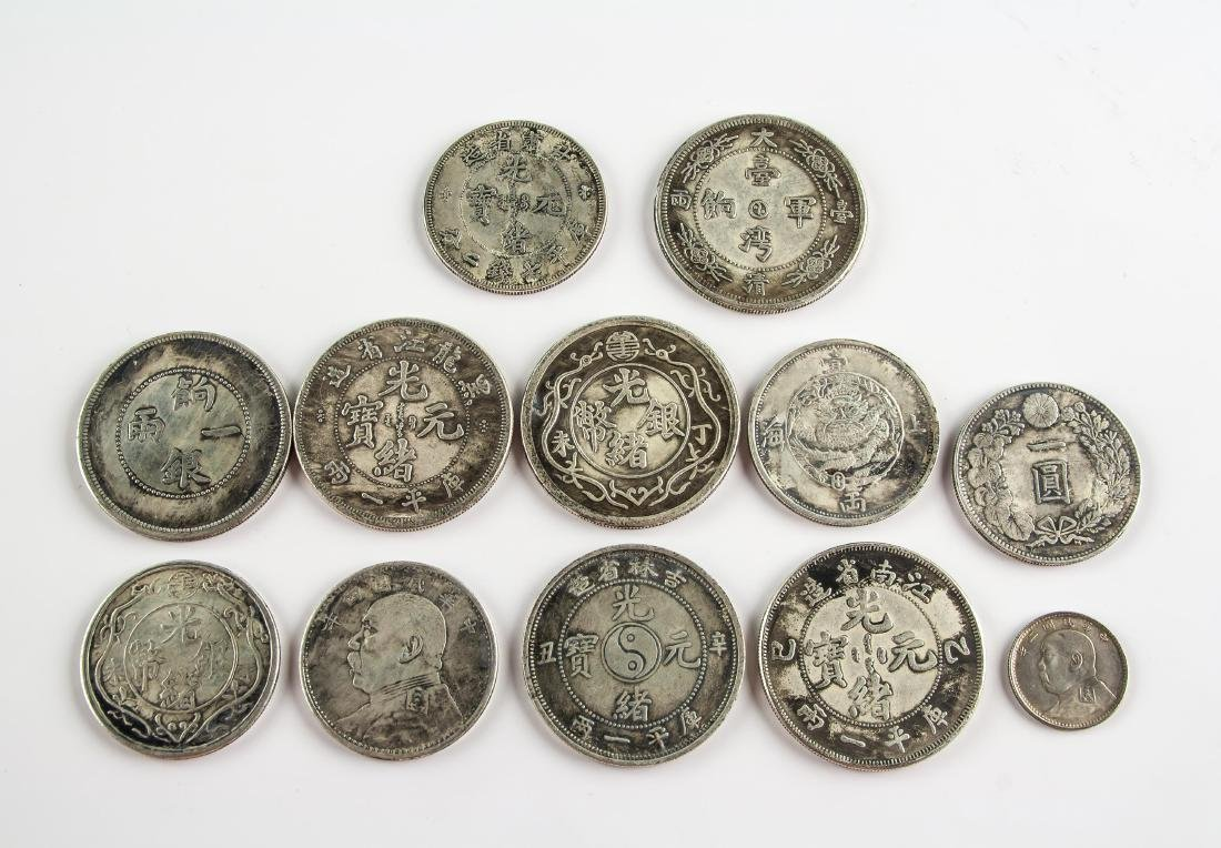 Eleven Assorted Silver and Pattern Coins