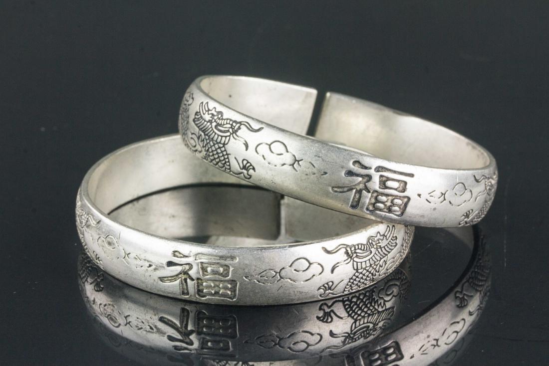 Pair of Chinese Silver Dragon Fu Shou Bracelet