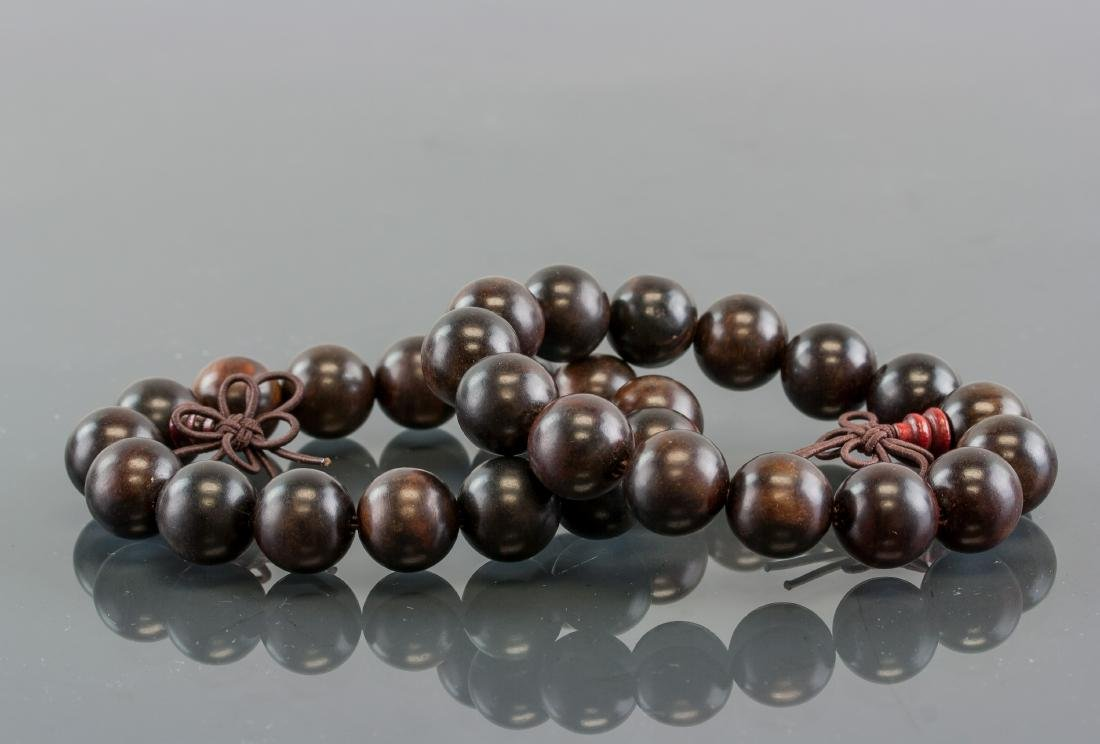 Pair of Chinese Wood Carved Round Bead Bracelet
