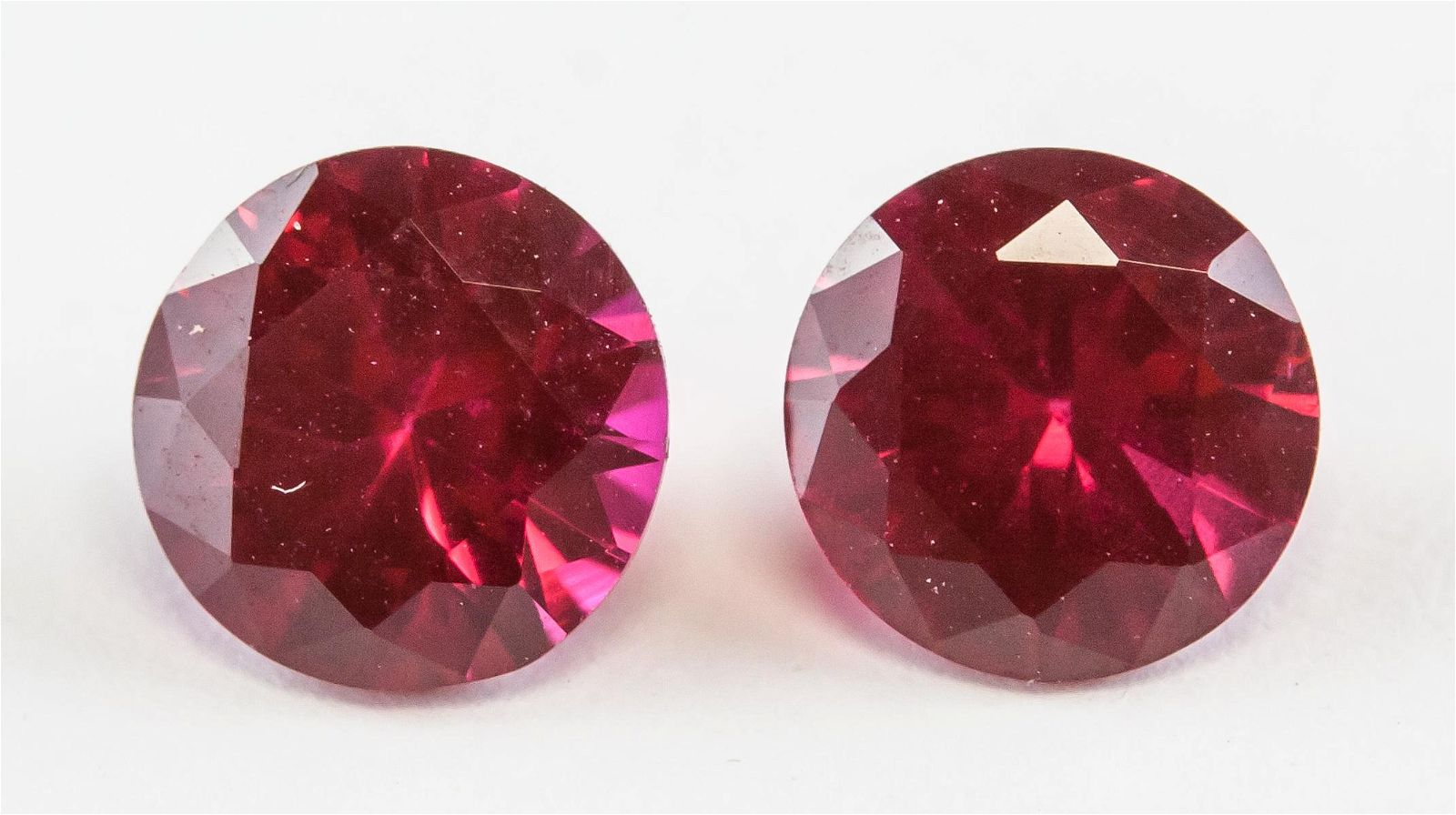Pair of 1.95ct Round Cut Natural Rubies GGL