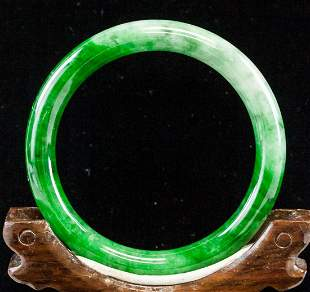 Carved Green and White Natural Jadeite Bangle GIA