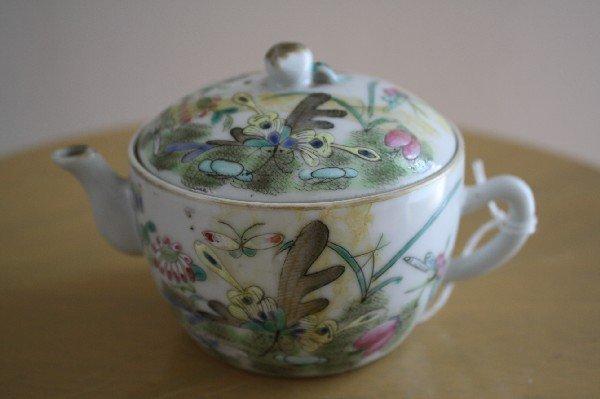 13: Porcelain lidded tea pot, painted with flower, butt