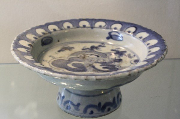 24: White & blue porcelain plate with high round foot.