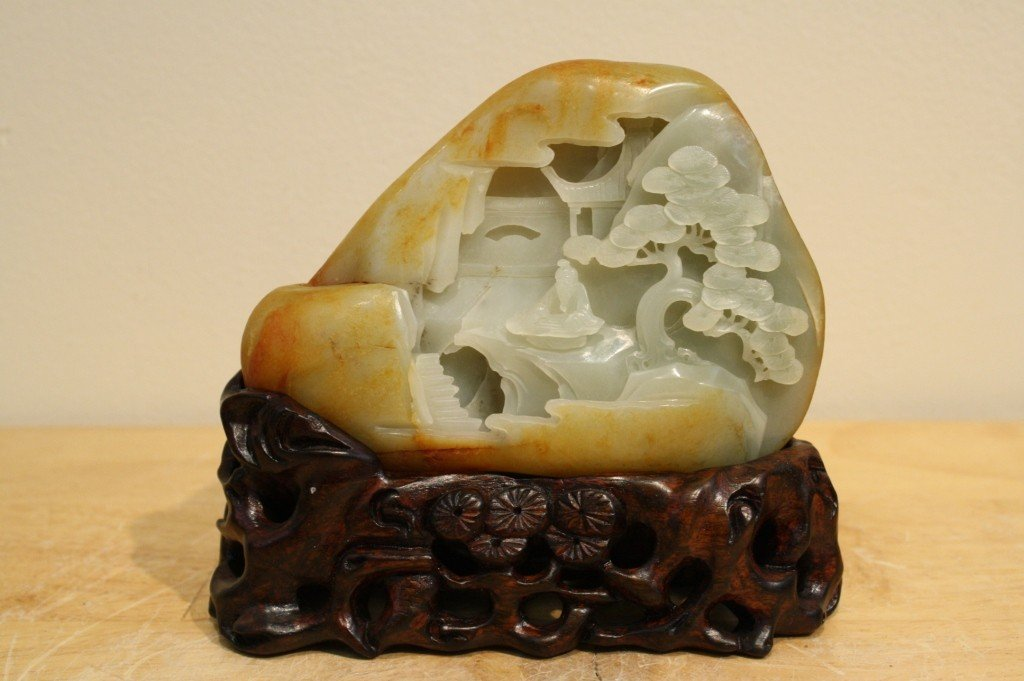 23: Chinese carved white jade boulder with russet patch