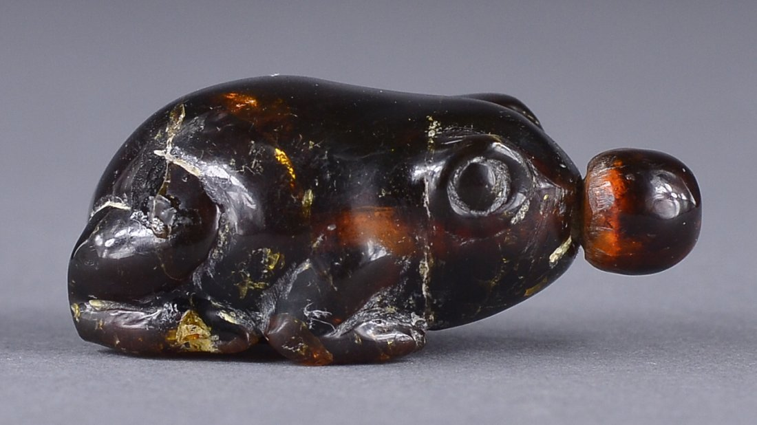39: 19th C. Chinese Carved Amber Snuff Bottle