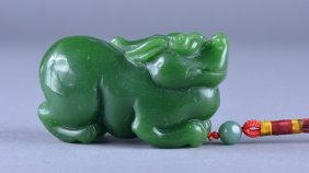 Chinese Carved Green Jade Toggle Of Lion
