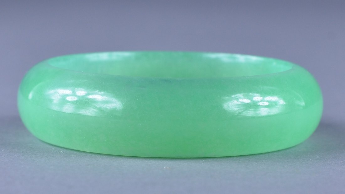 219: Chinese Carved Green Jade Bangle