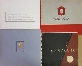 Four large Cadillac catalogs