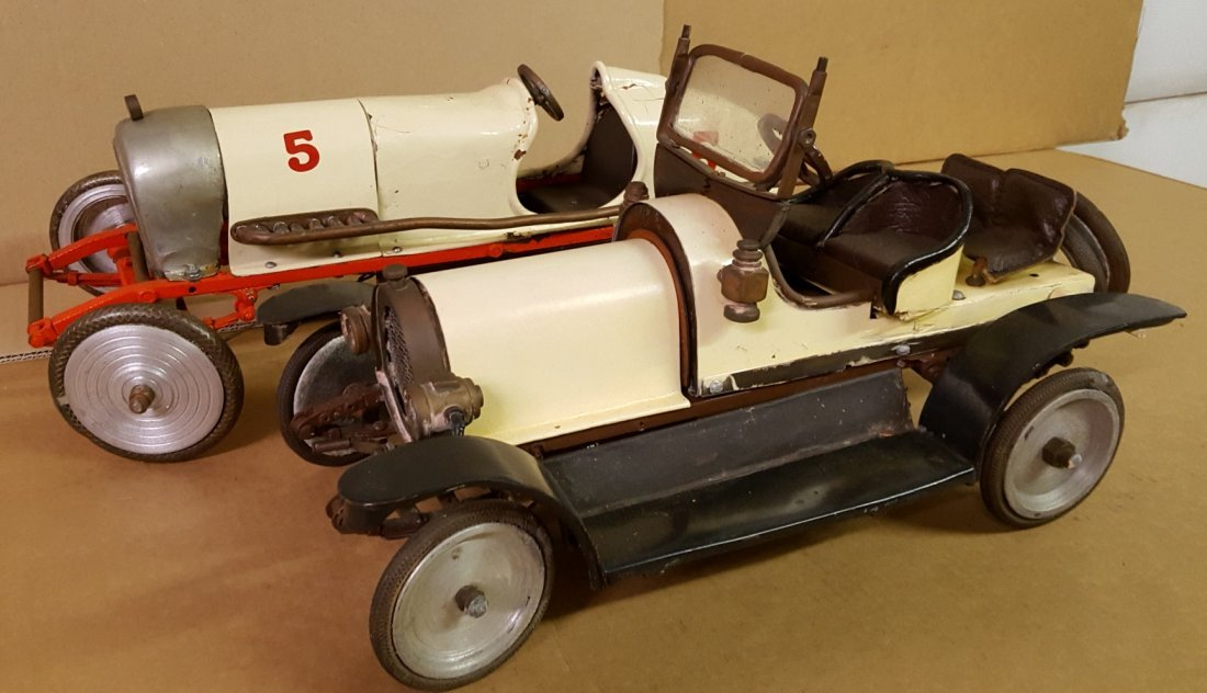 Two folk art model cars