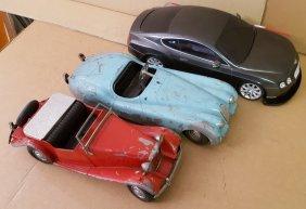 Three toy cars