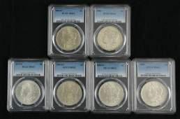 Six Mint State Morgan Silver Dollars