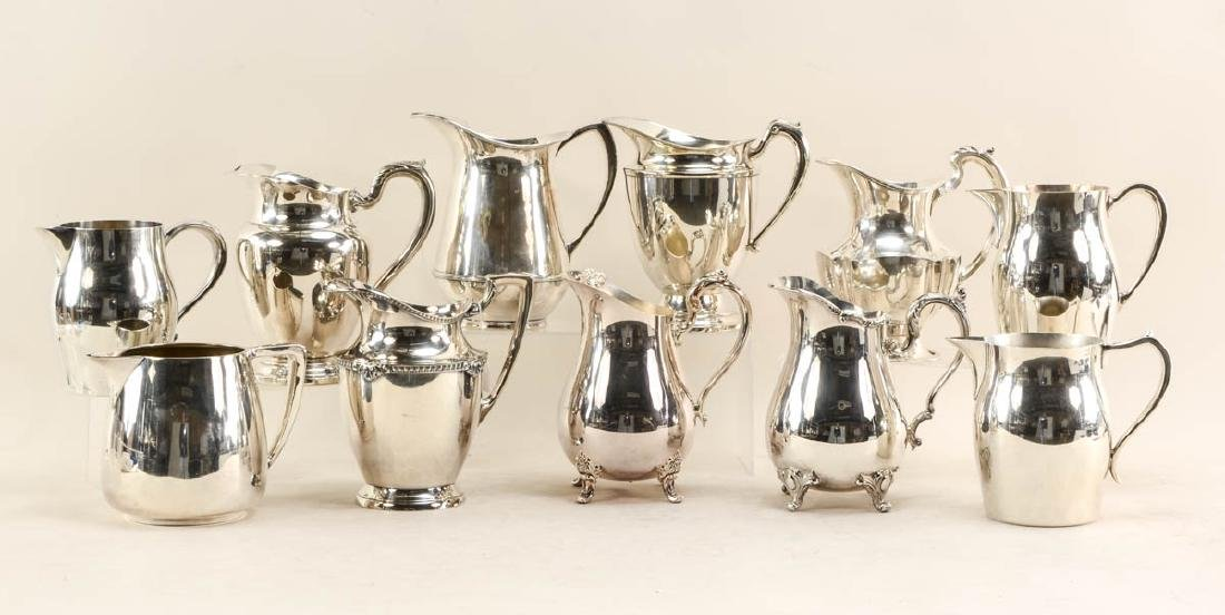 11 silver plate pitchers