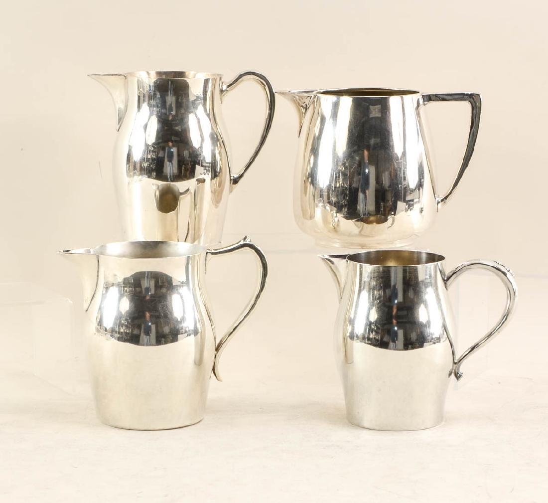 11 silver plate pitchers - 4