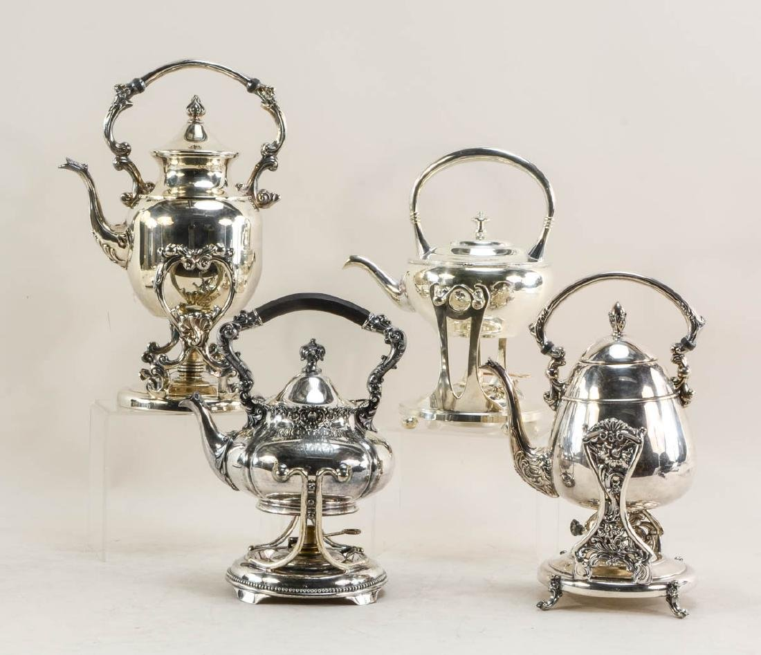 Four Silverplate Tilting Tea pots