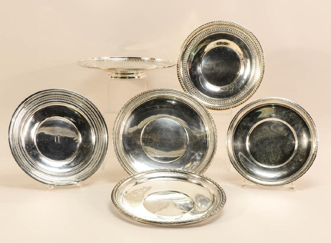 Six Sterling Silver Plates