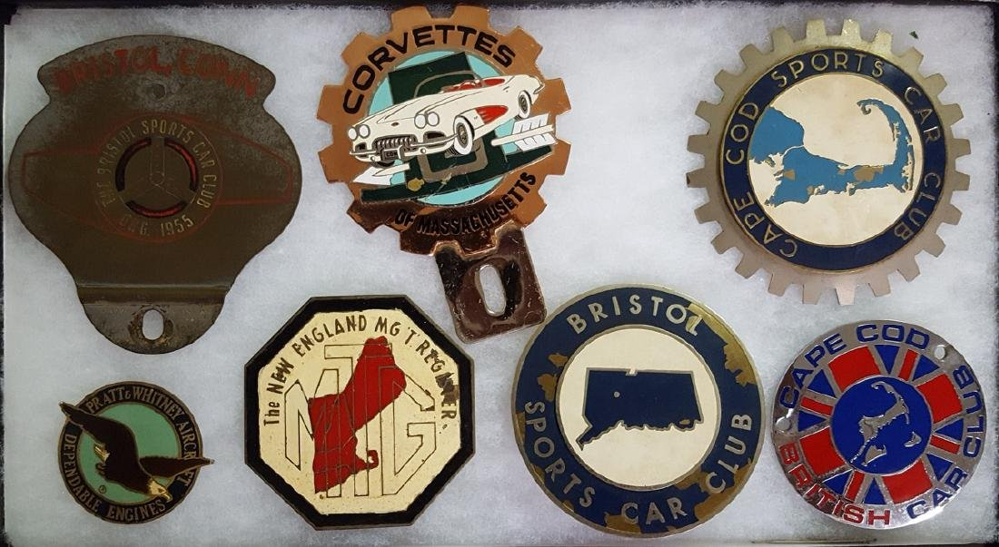 Six New England club badges
