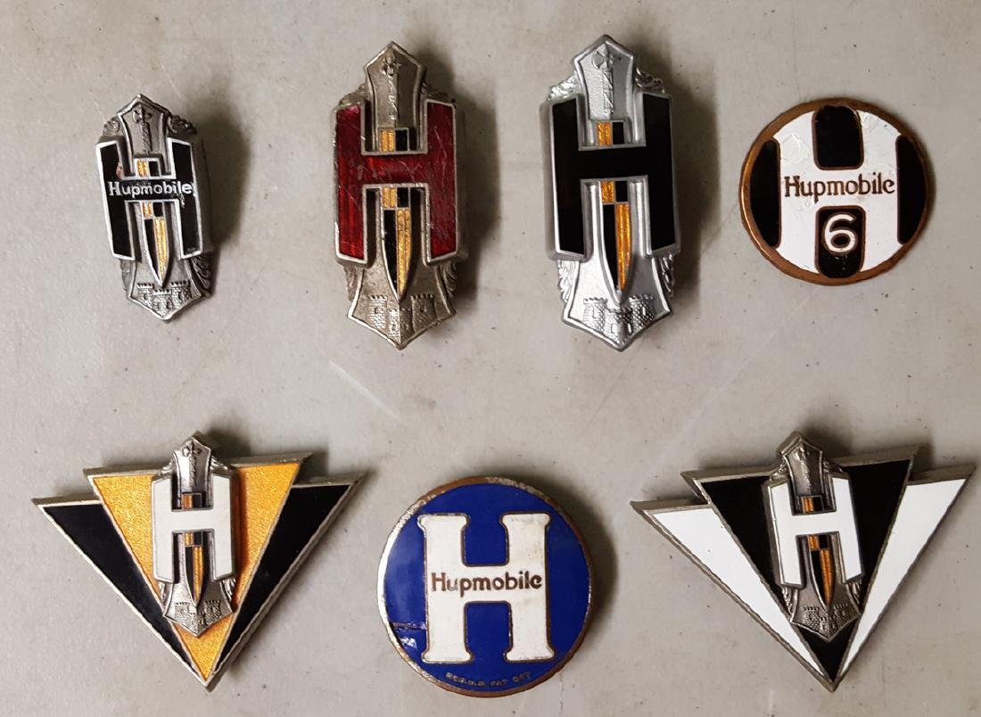 Seven Hupmobile radiator badges