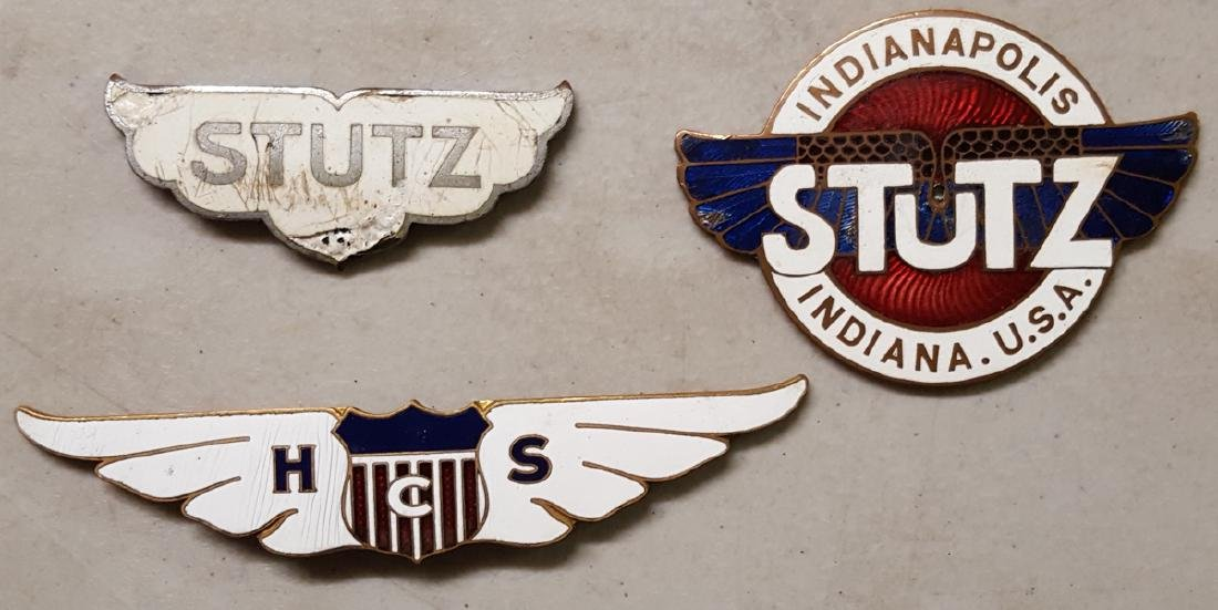 Two Stutz and an HCS radiator badge