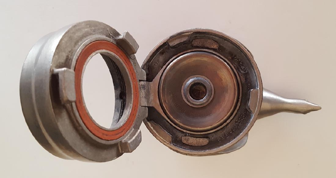 Two original Model a quail caps