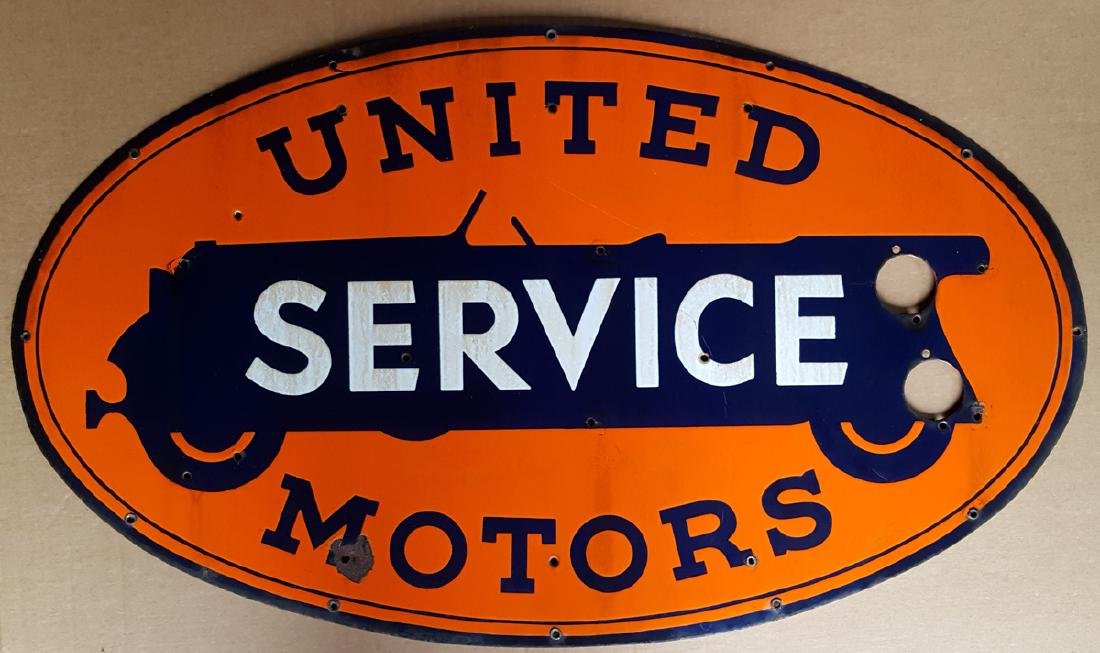 United Motors neon face sign