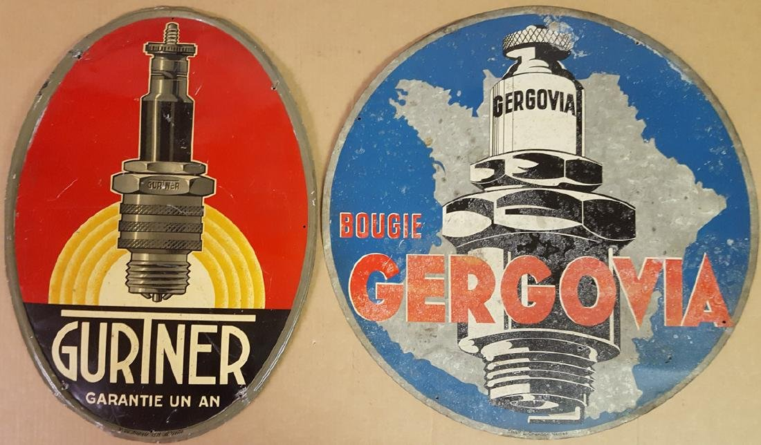 Two spark plug signs