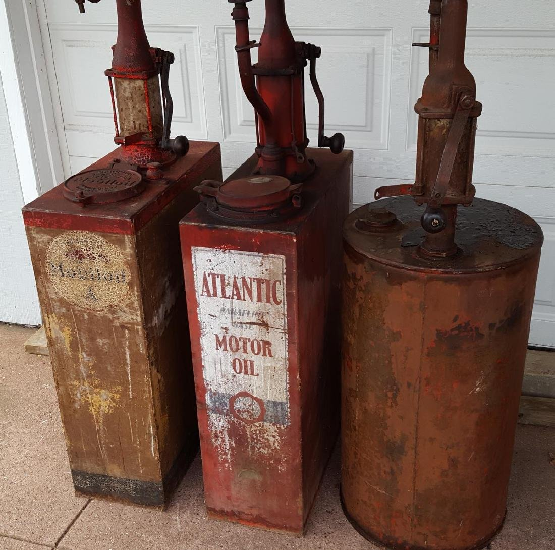 Three garage oil dispensers