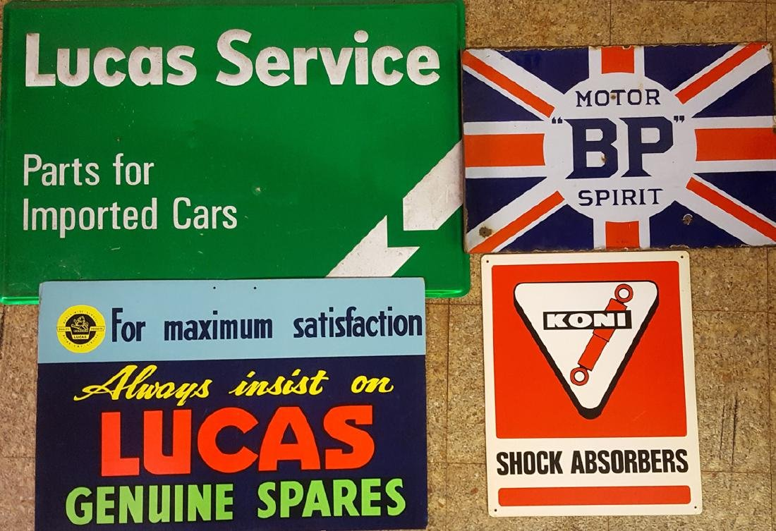 Four British car related signs