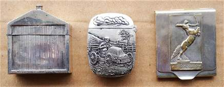 Three silver plated match safes