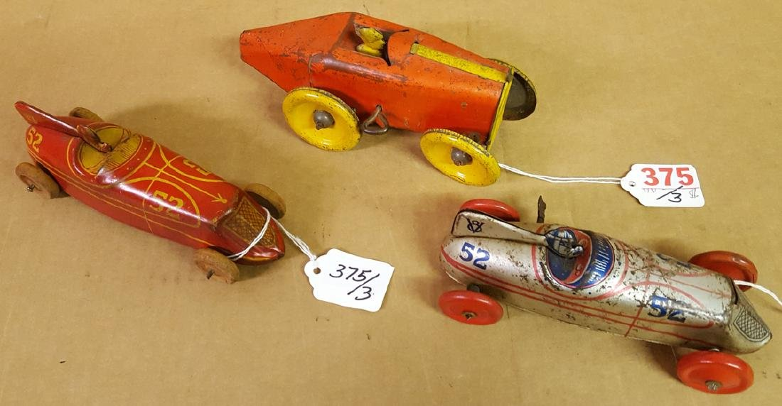 Three tin toy racers