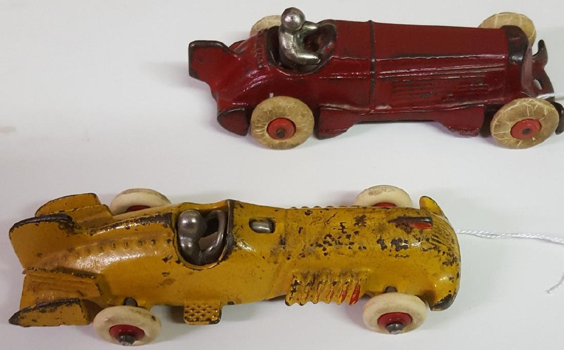 Two toy cast iron original racers