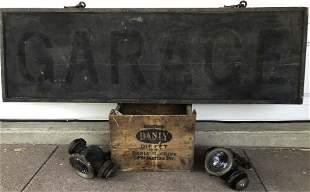 Old wood garage sign with original brackets